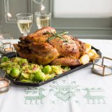 Stuffed Capon with goose-fat roast potatoes and bacon brussels sprouts