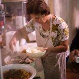Woman preparing pasta at the masseria