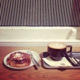 Coffee and a cinnamon bun at Monocle café