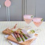 Ham-wrapped asparagus with a strawberry basil fizz