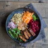 Green Goodness bowl: Tempeh, quinoa, peanut miso dressing, carrot, beetroot, pickled onion and herb salad