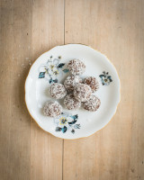 Plate with brown truffle rolls covered in coconut flakes