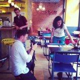 Filming at a burger restaurant
