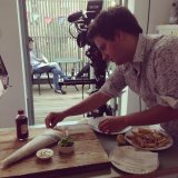Food assistant Ryan styling the final food shot of the fish and chips.