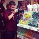 Arthur being way too serious for filming in a candy store!