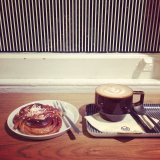 Coffee and a cinnamon bun at Monocle café