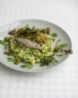 Herb-crusted cod with pea risotto
