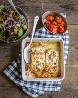 Baked feta with cherry tomatoes and bread salad