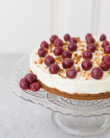 Cheesecake with speculoos bottom, topped with cherries and winter decoration