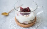 Cup with fruit bread, yoghurt and damson compote and snowflakes decoration